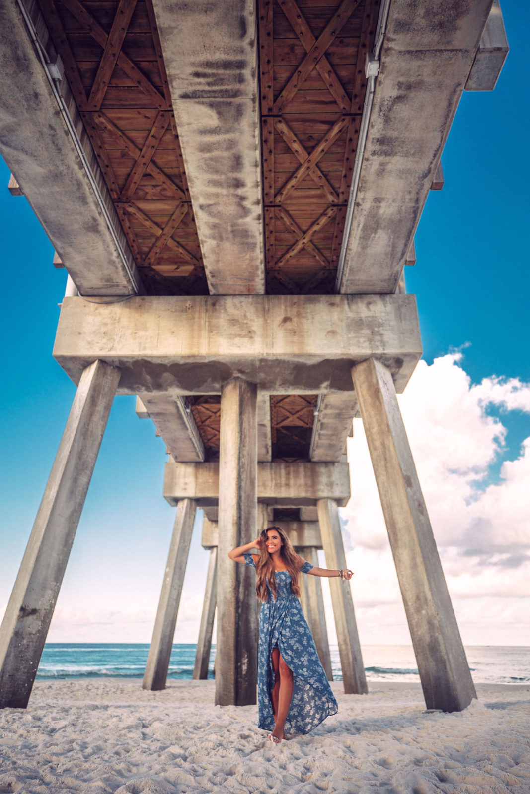 under the pier at panama city beach florida in a maxi dress