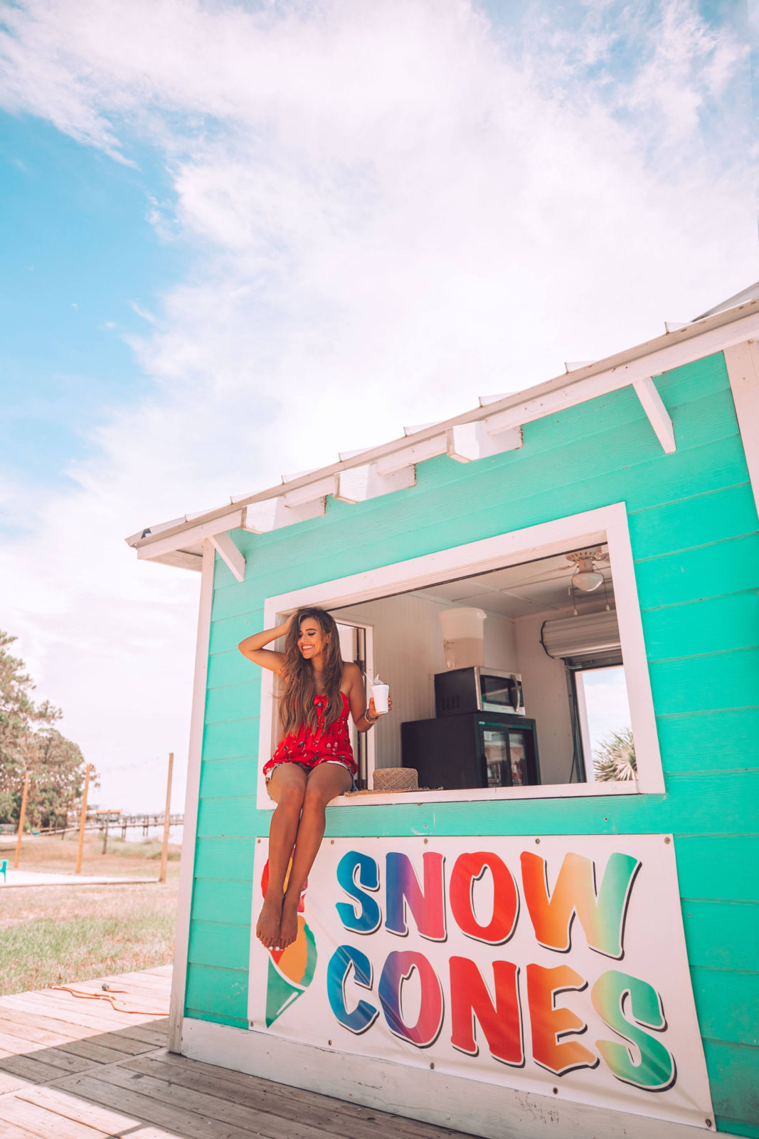 enjoying a snow cone at the beach in florida